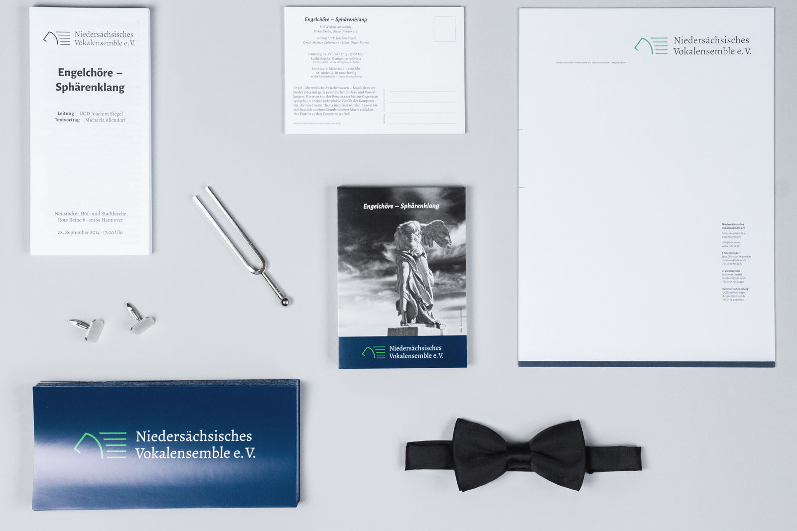 Concert program, post cards, letter head and flyer together with cuffs, a bow tie and a tuning fork.