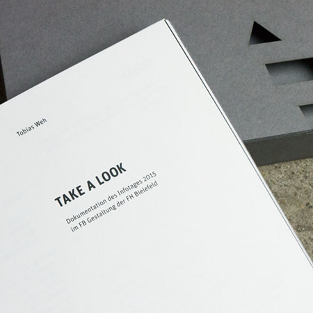 The inner title page and the slipcase in the background.
